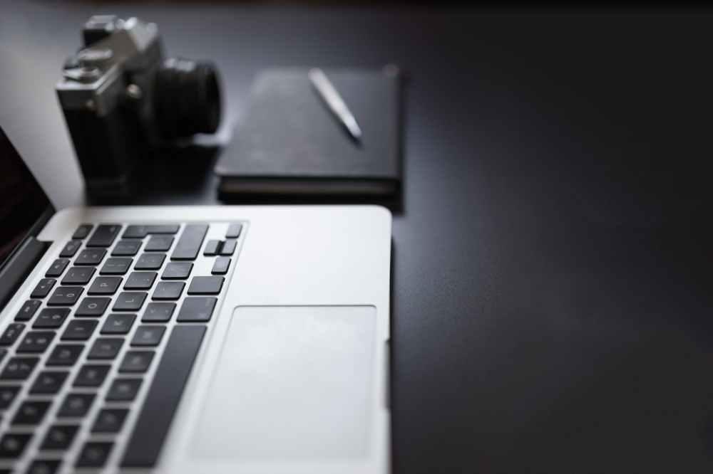 dark notebook pen photography